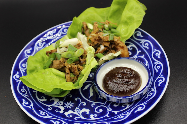 Mu-si (pronounced moo-shu) Pork served in butter lettuce wraps with Hoisin sauce on the side.