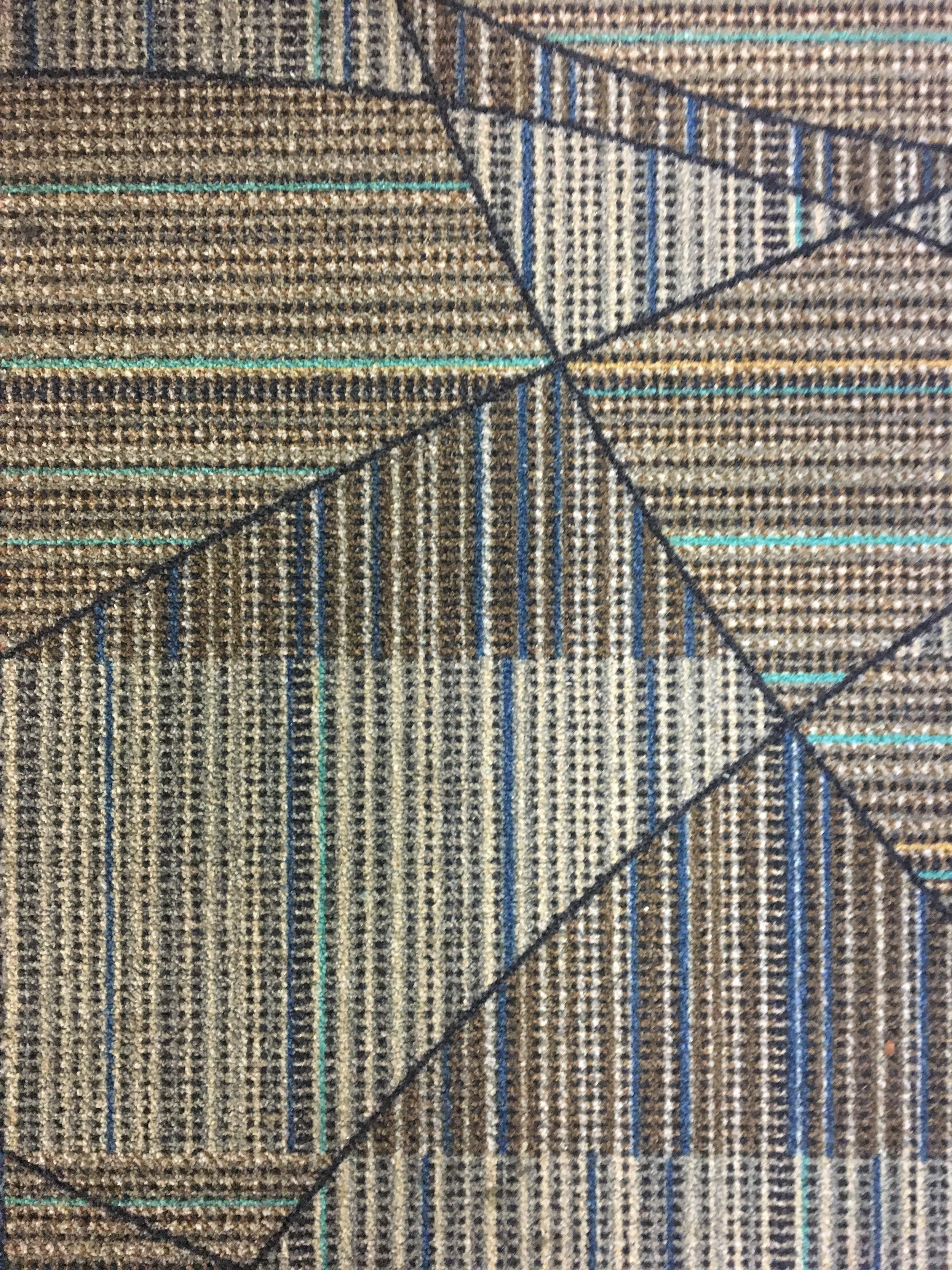 ALONE // Airport Carpet Zine: Photograph of geometric carpet pattern at FLL (Ft Lauderdale, FL)