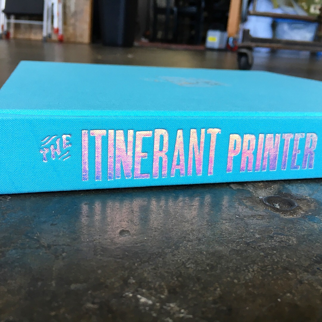 The Itinerant Printer Book // layout & design Image: book spine with holographic foil