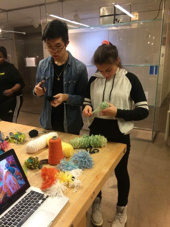 Making some pom-poms together!