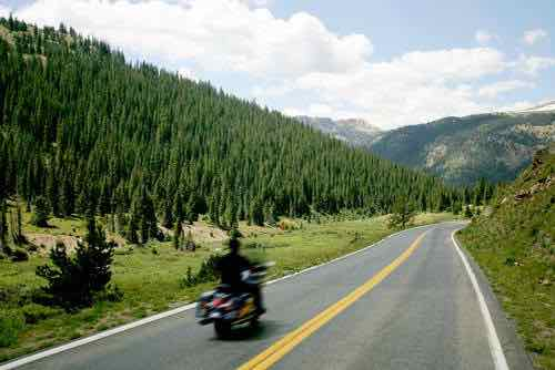 Motorcyclist on country road.