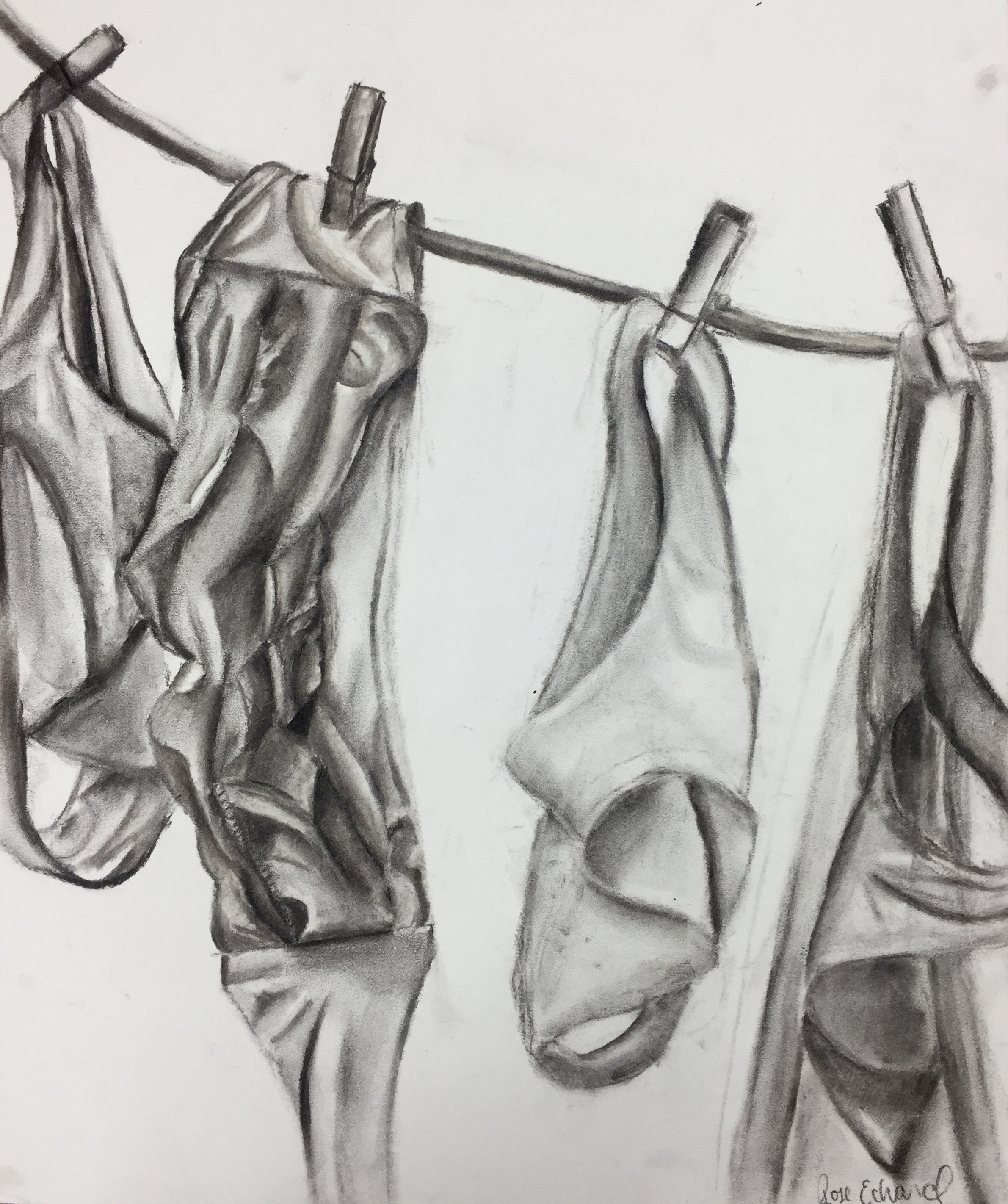 charcoal still life of swimsuits
