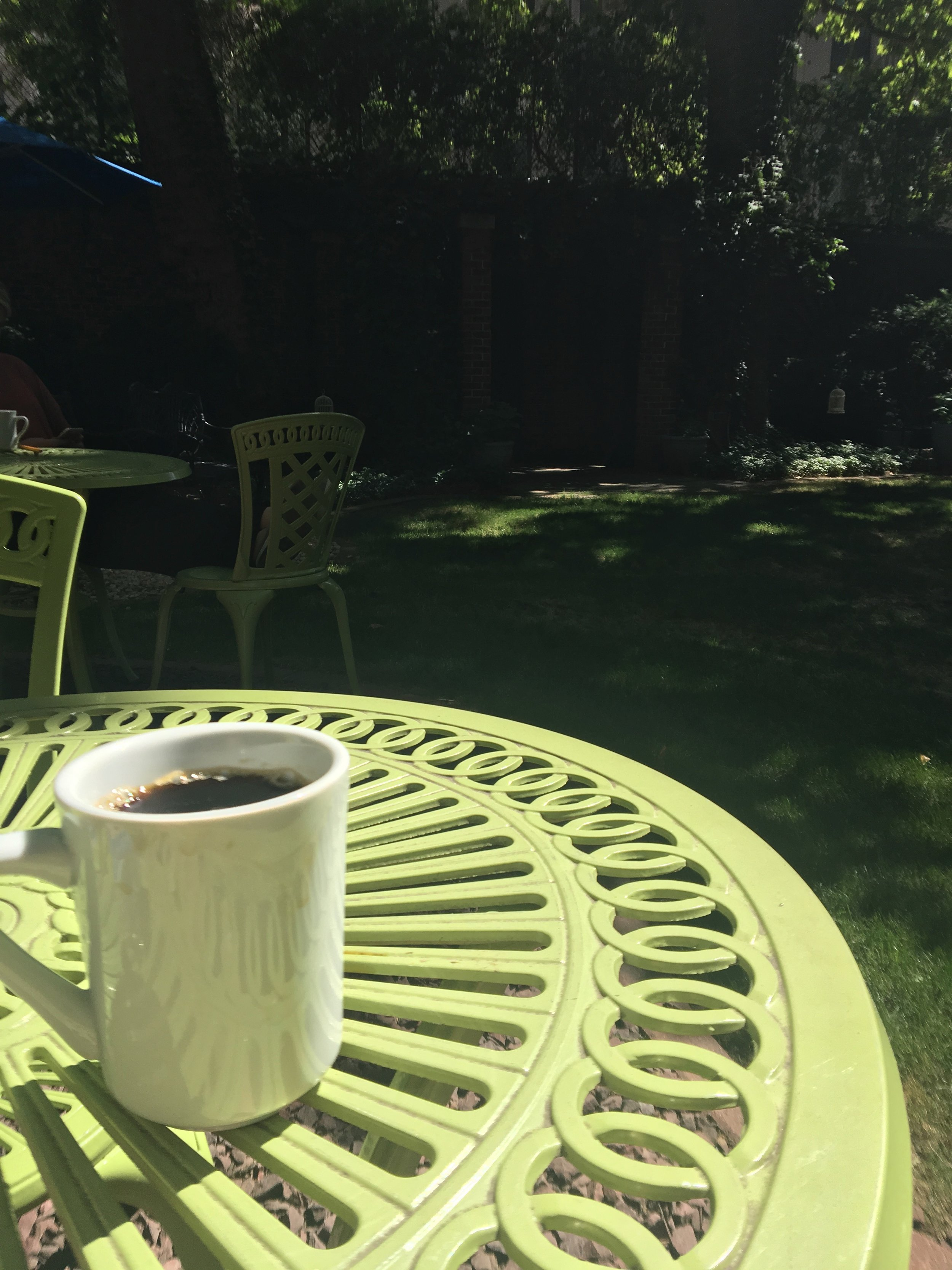 Enjoying Coffee in the Backyard of my Apartment