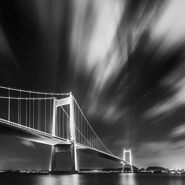 An oldie but a goodie :) and one of the most spontaneous shots I've taken.  While driving home late one night, I drove across this bridge cone I cross almost every day, but on this special night, the clouds were perfect, both in direction, formation, amount of coverage.. Shot with my @canonnordic Camera :)