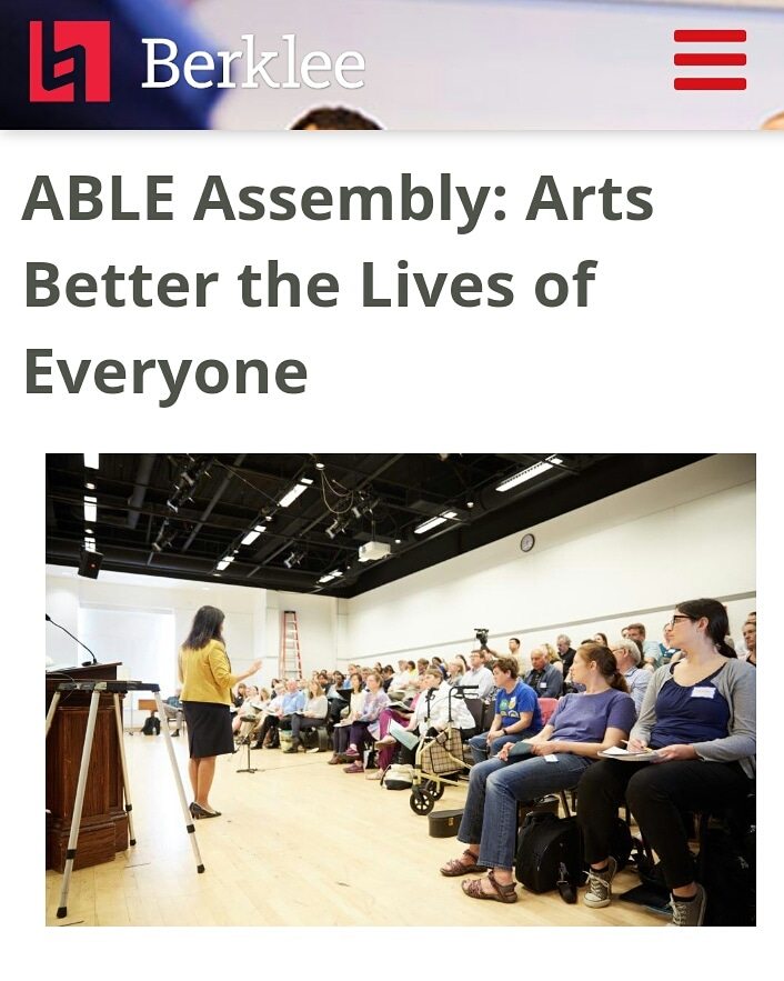 Screenshot of flyer for Berklee College's ABLE Assembly. Woman in yellow jacket and black dress speaks to an auditorium full of people sitting and listening attentively, some taking notes others just watching.