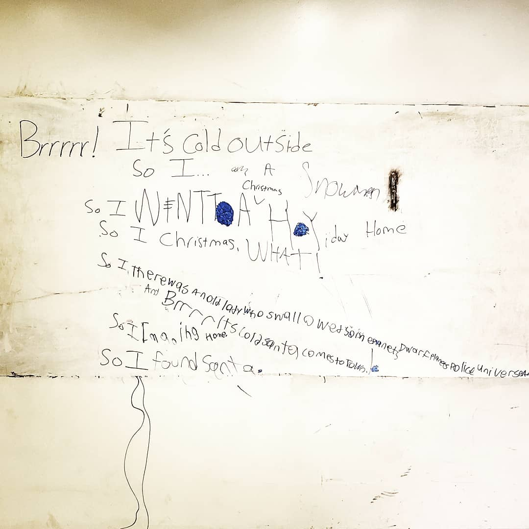 "Words on a white board in black expo marker read ""Brrrr! It's cold outside so I…"" with various student answers written. The answers are hard to completely discern at the distance of the photo."