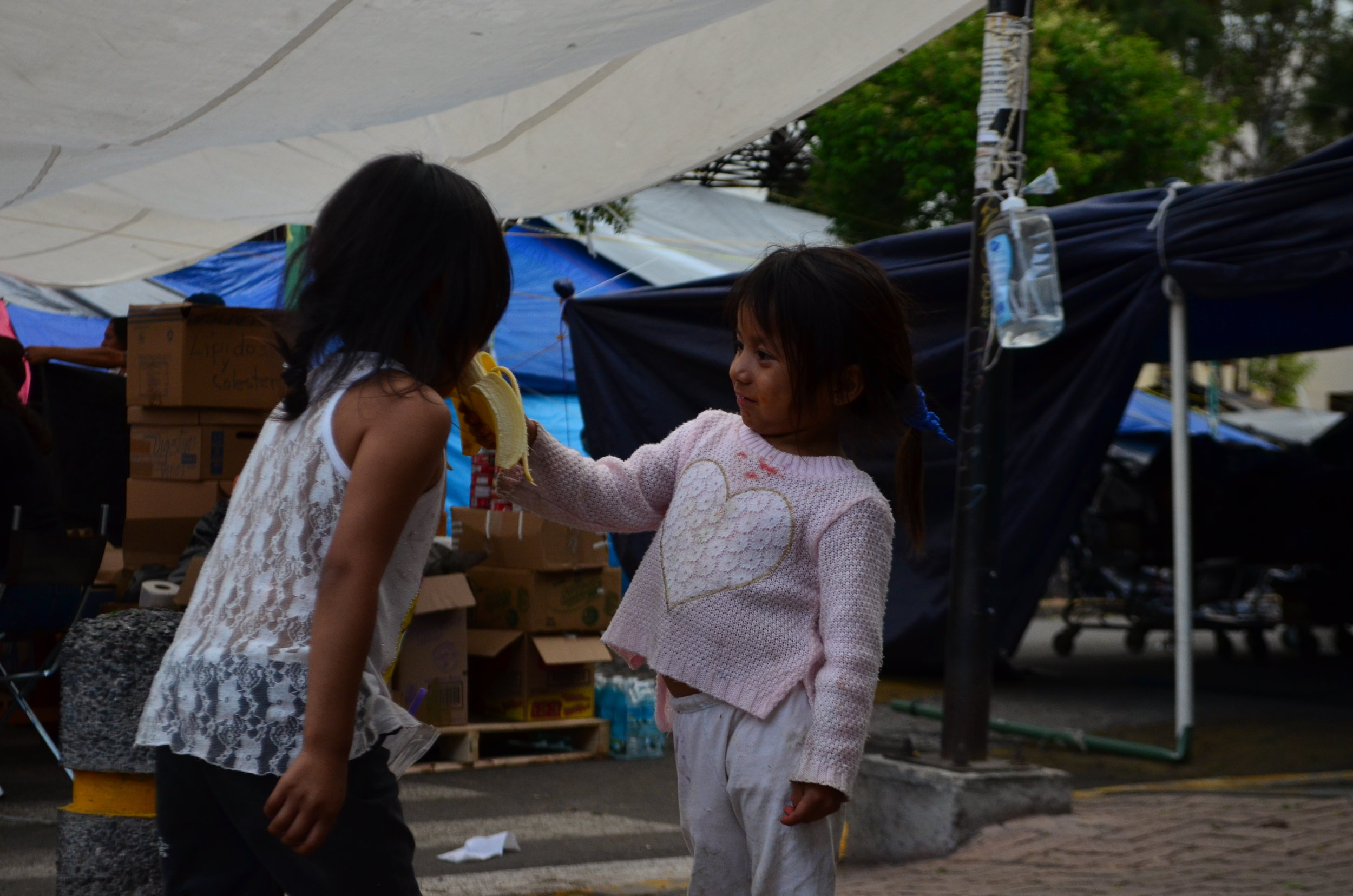 Two girls playing at the teacher's union camp in the Historic District of Mexico City in June 2016. Teachers, mostly from southern Mexican states but also from Mexico City, Sonora and Sinaloa, camped out in Mexico's capital for months in protest of an education reform sponsored by the Enrique Peña Nieto administration.