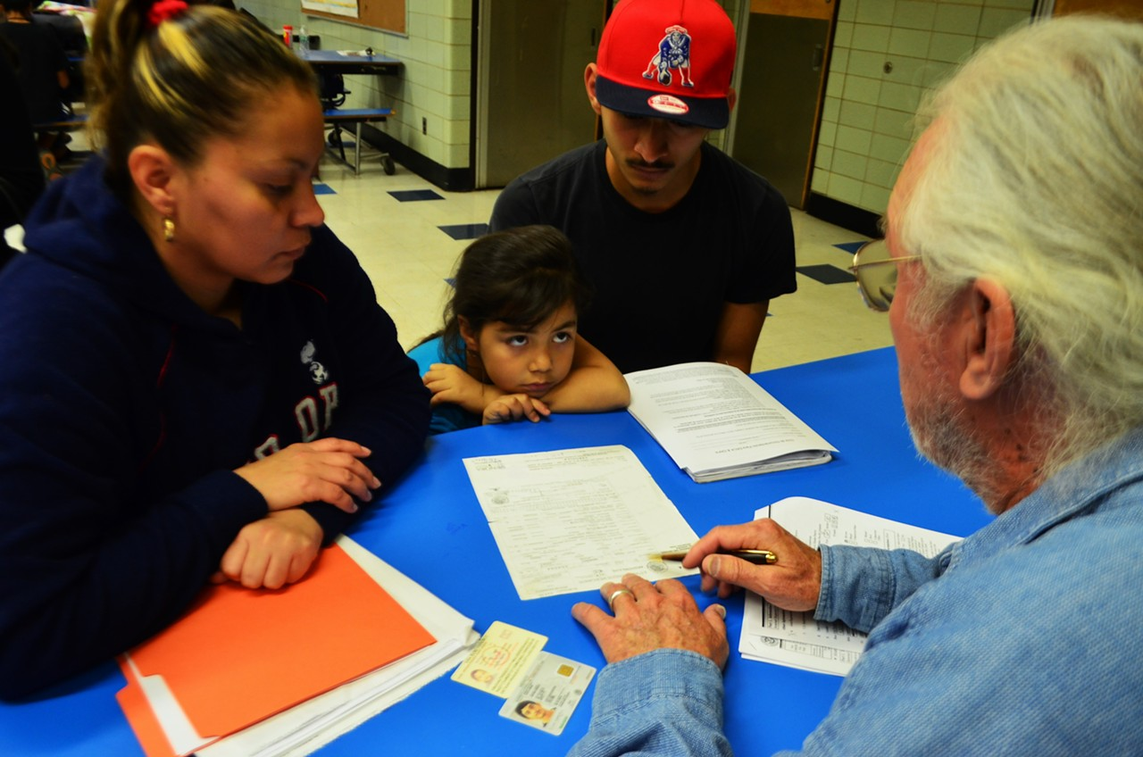 Jazmin Huguez, Eliot Ortega and volunteer Steve Johnston at Keep Tucson Together's educational clinic at Pueblo High School.