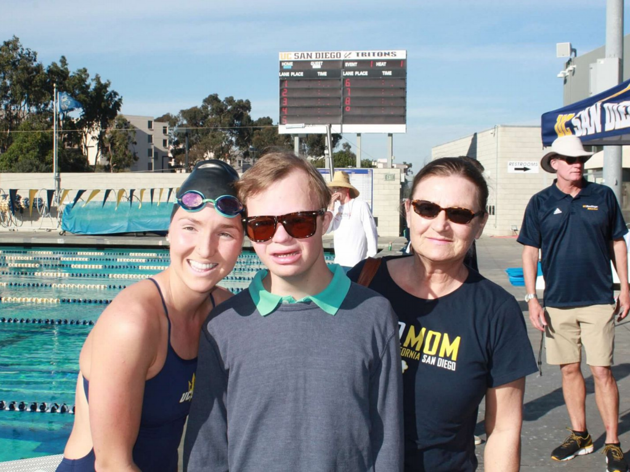 My Mama and Michael visiting my last home meet as a Triton this past January.
