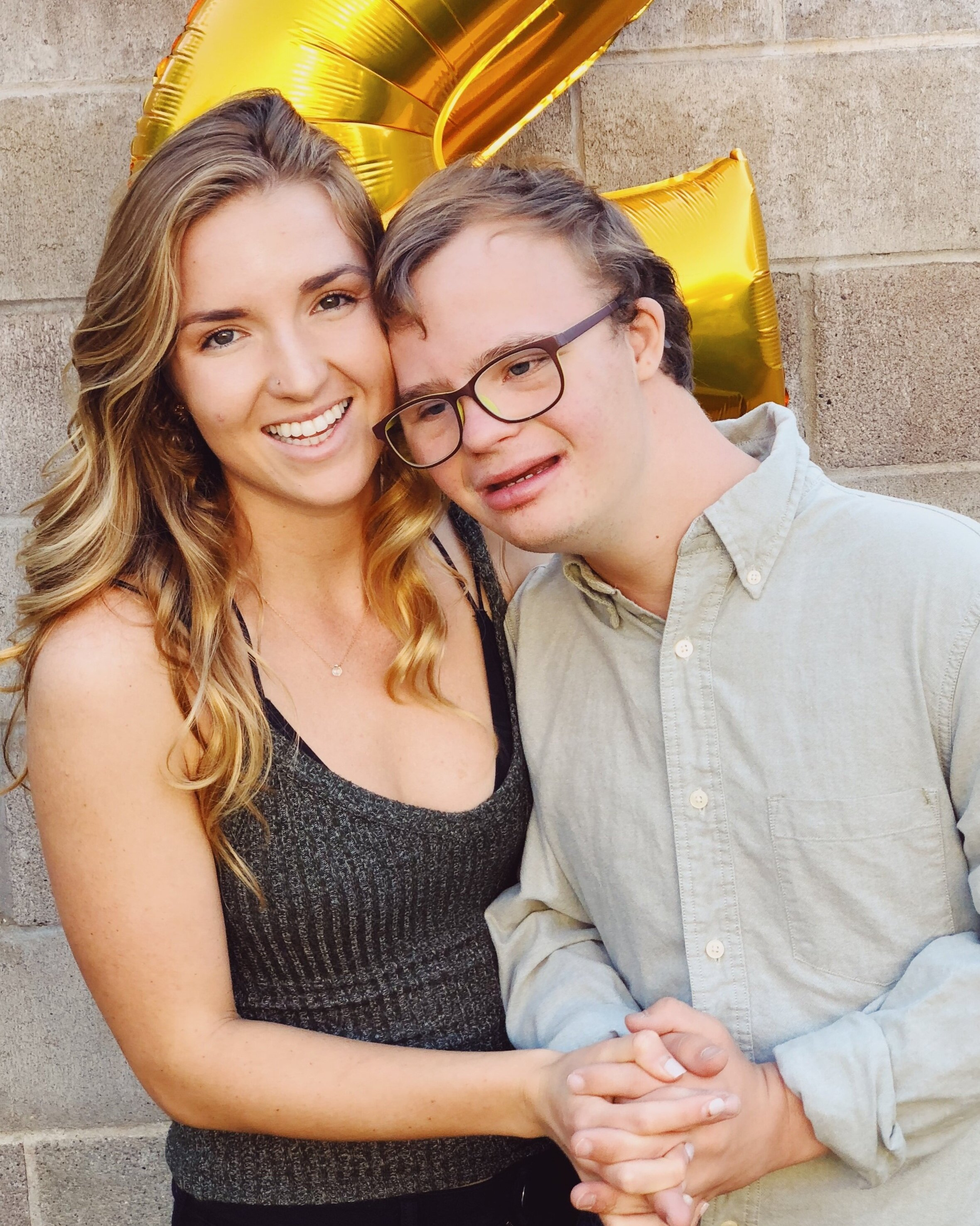 Our Mission - Hello! I'm Julia, and welcome to Beyond the Waves! My twin brother Michael was my inspiration to make this website. Michael is on the severe side of Down Syndrome, and is completely non-verbal. However, that doesn't stop him from enlightening those around him with his kindness and love.My mission is to share the lessons I've learned in Self-Love through growing up with Michael. To provide a means of healing while empowering you to achieve what makes your heart sing. All while revealing the beauty behind each individual who has Down Syndrome.Learn More