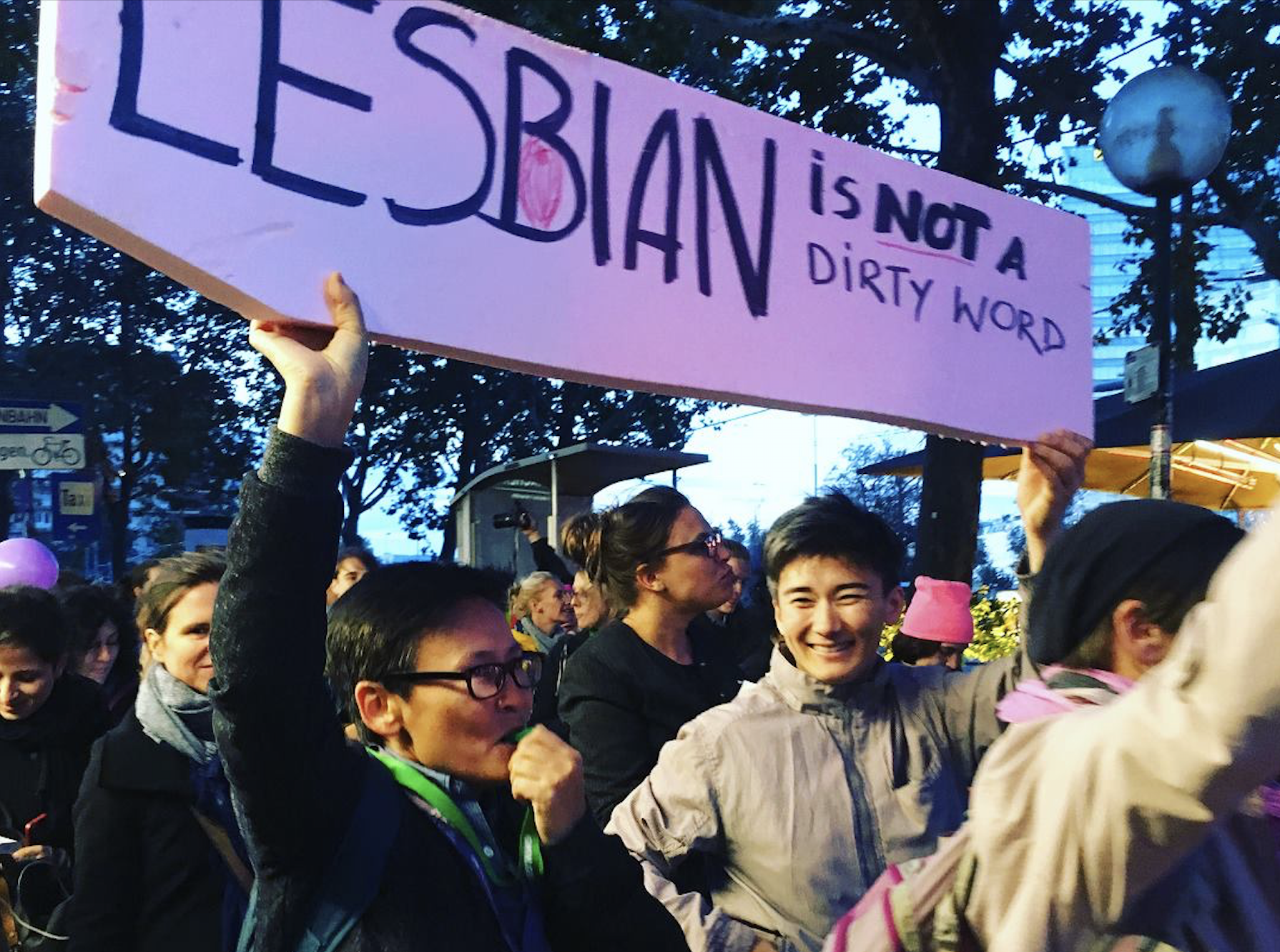 "Image: Co-founders of 'Feminita' Gulzada Serzhan(left) and Zhanar Sekerbayeva attend a protest holding a sign which reads ""LESBIAN IS NOT A DIRTY WORD""."