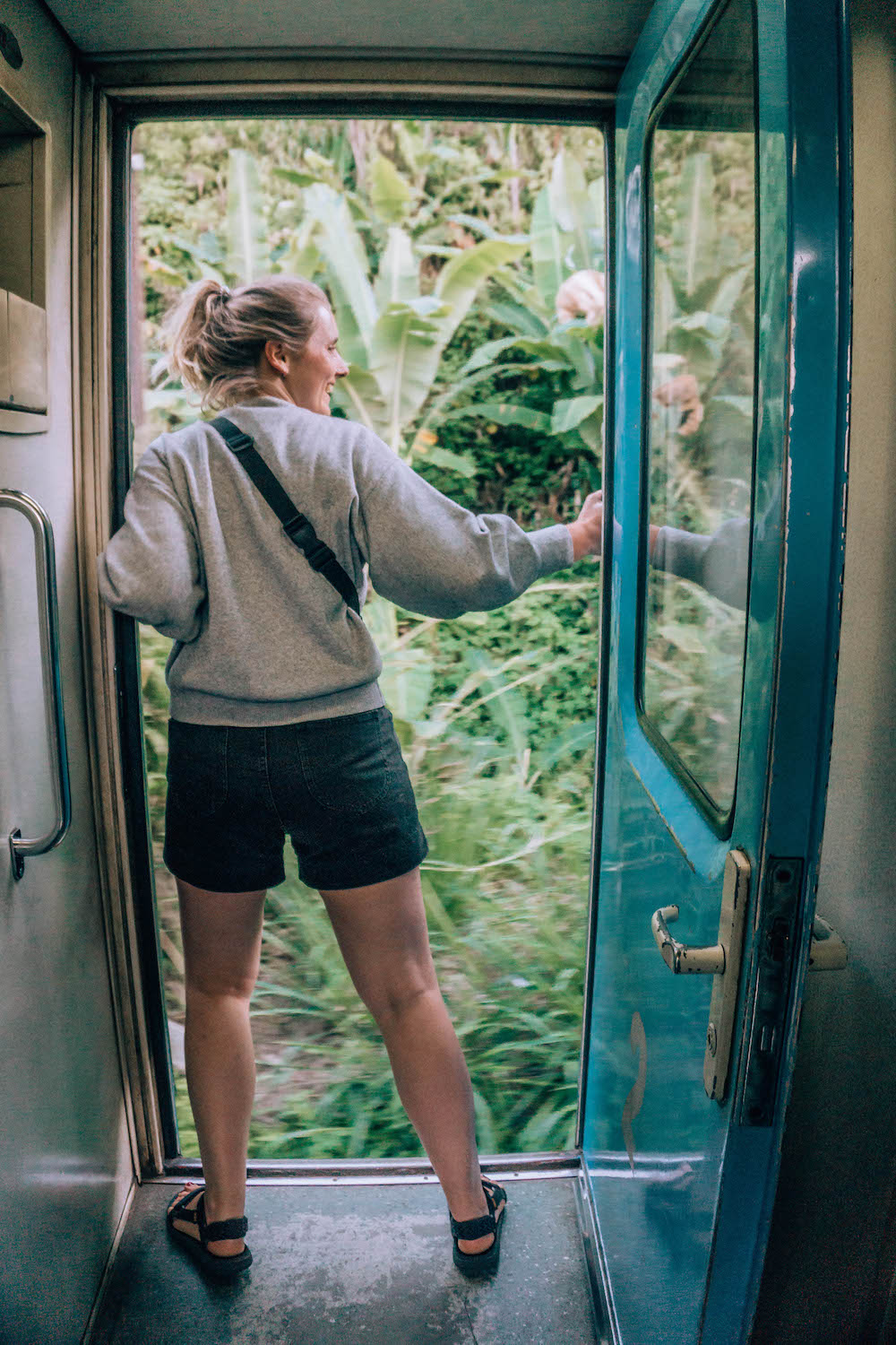 One of the many friends we made on our journey, all crammed in the doorway compartment. We took turns sitting in the doorway, and helped each other snap those epic Ella Train photos!
