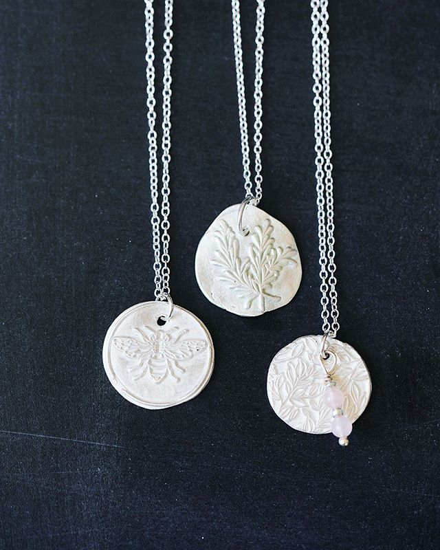 "These three beauties right here have cause quite a stir the last 24 hours. Lots of folks cheering me on the ""THIS is what you need to be doing"" path. • I have wanted to master working with all metals, especially silver, for a decade now.  This is the year I'm going for it. • These simple little tokens each have a meaning...because my heart will always be into creating little works of art with meaning.  Even if the wearer is the only one who knows that meaning.  Call them lucky charms or jewelry with soul...whatever you want to call them there will be more coming. • My ""vision"" is to keep @theinspiredpoppy line of lovelies as costume jewelry fun stuff that I can continue to sell locally in the shops and for my higher end pieces to go under the Tisha Lyn umbrella .  For the obvious reasons I am way more protective over the high end lovelies and will be selling them online & at trunk shows this Fall.  More info coming soon! • And because so many have asked...Yes, I do take custom orders for those who need a little charm that has meaning to them alone.  Little bits of heart and soul will always make me smile 😊💗. Thanks for all the cheering my friends...figuring out how to make dreams happen truly is not an easy or fast thing but I am a patient, persistent...not afraid to fail Taurus if nothing else in life🙈. I will just keep moving, shifting and going with life until I land where I am supposed to. This feels like the ""I'm supposed to..."". We shall just go down the rabbit hole and see where it leads.  But Lordy do I have a million creations in my head...can't wait to make them!"