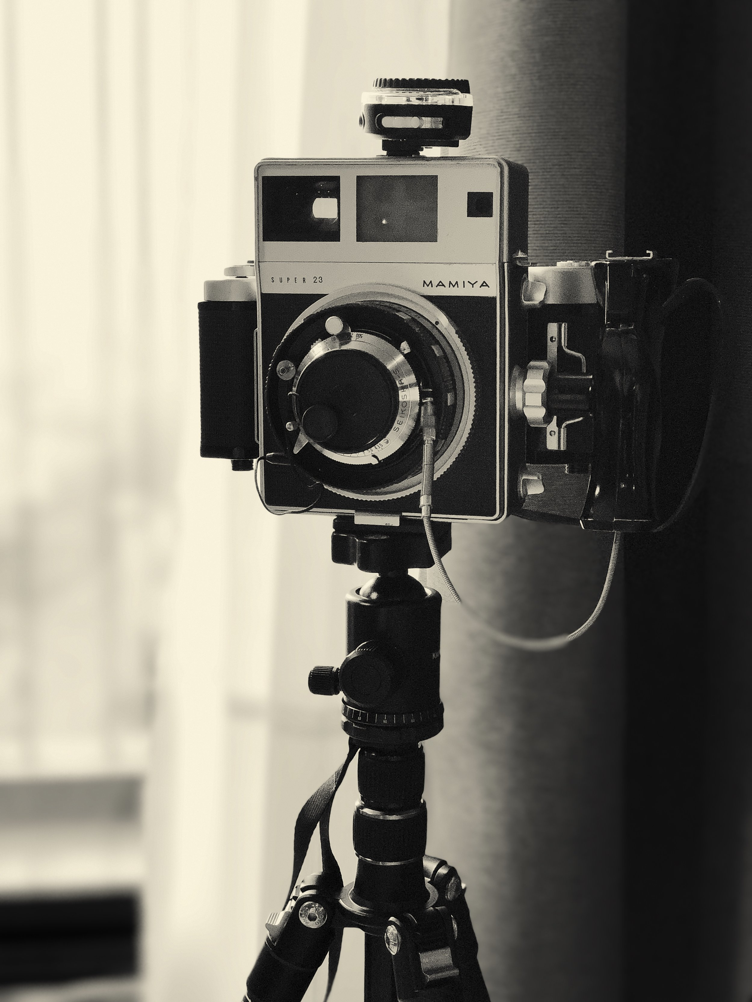The Super 23 fitted with a Sekonic light meter.