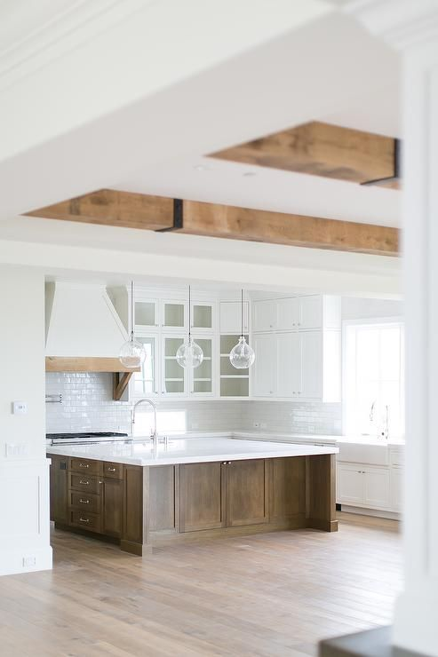 white cabinets, beams