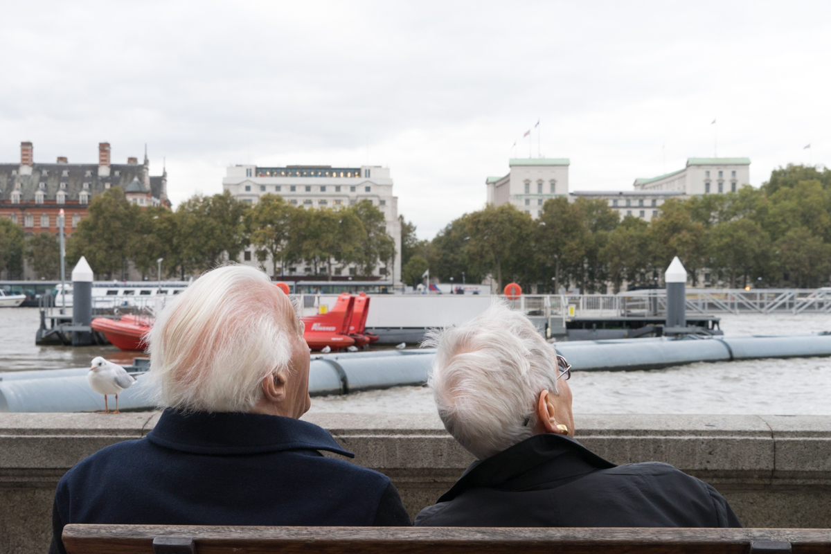 An older couple watching the spinning London Eye