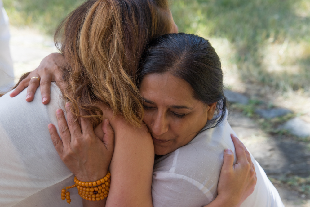 Two of my fellow yogi friends showing gratitude for each other during our YTT graduation ceremony.