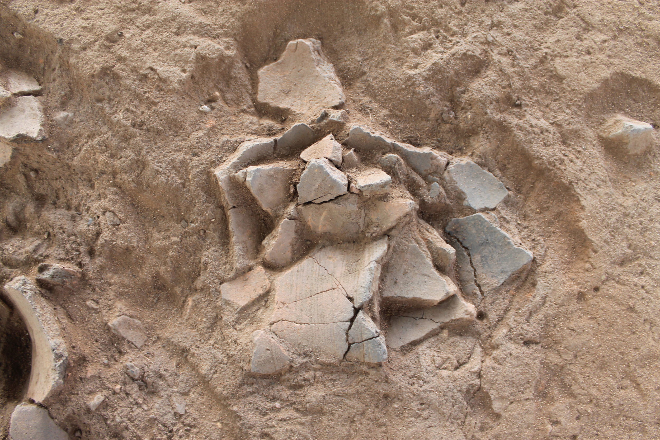 In-situ ceramic clusters at the Early Iron Age site of Chundu Farm in southwestern Zambia.
