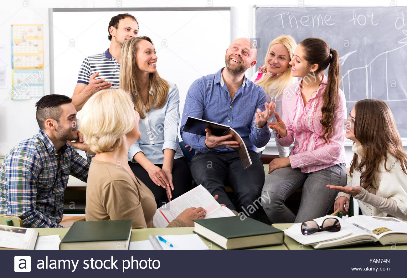 charming-language-teacher-is-telling-interesting-stories-to-his-attentive-FAM74N.jpg