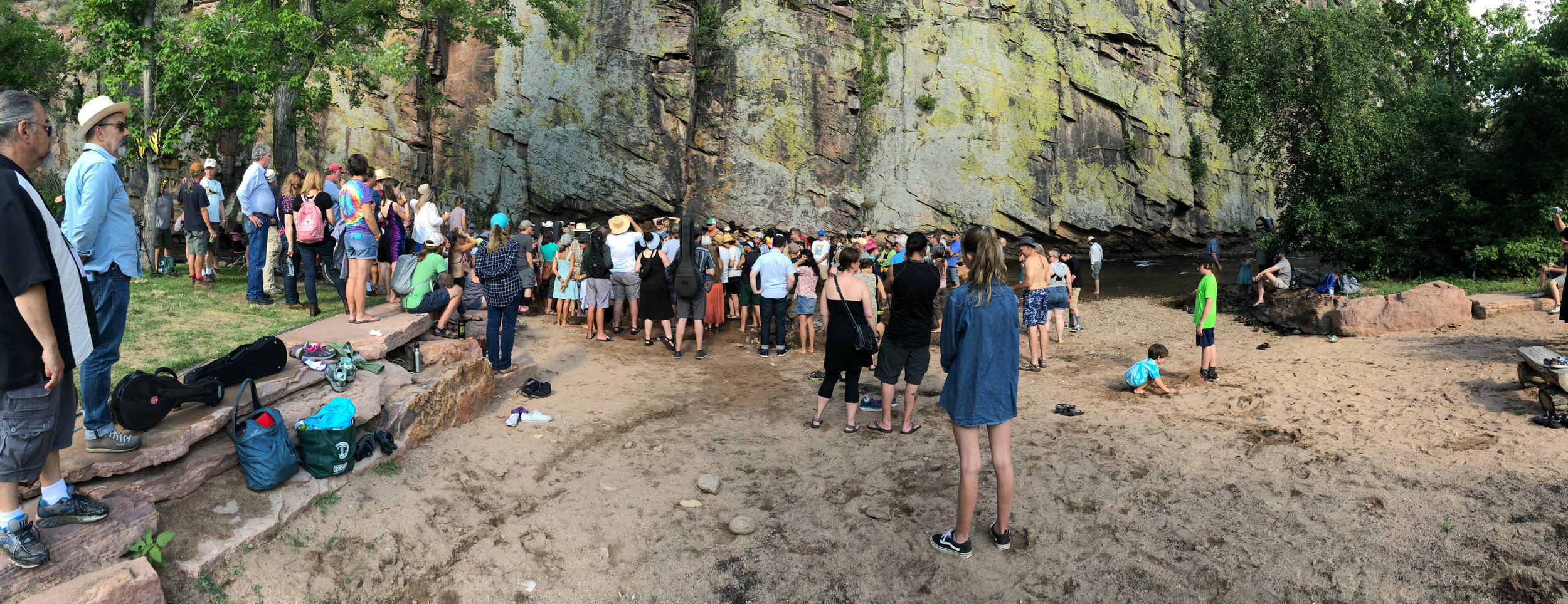 Attendees at the 2017 RockyGrass Academy singing gospel in the St. Vrain river at the culmination of the Academy.