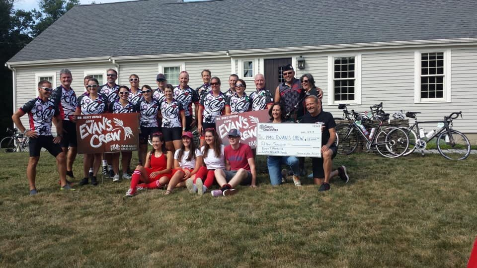 - Teresa & Jim Gaudet presenting a $15,000 check to Evan's Crew at one of their rest stops along the pan mass challenge route.