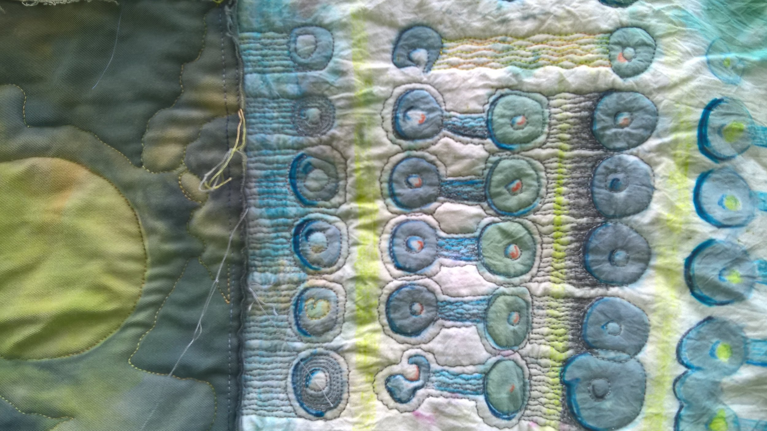 Hand-dyed fabric with hand-stitched detail