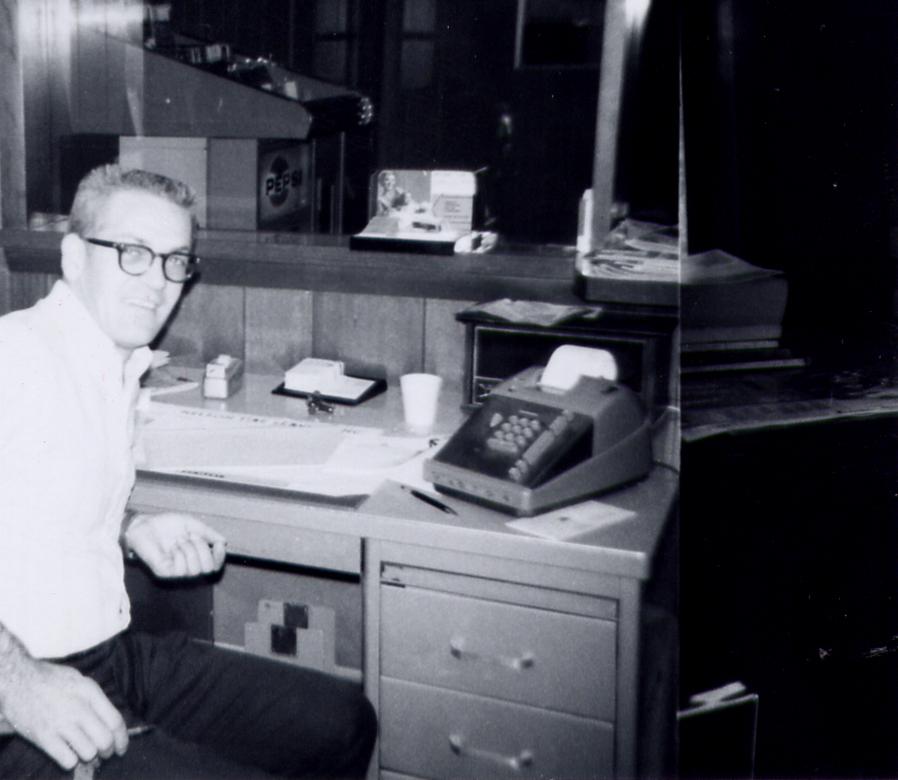 Kenny Snedeker at his desk.