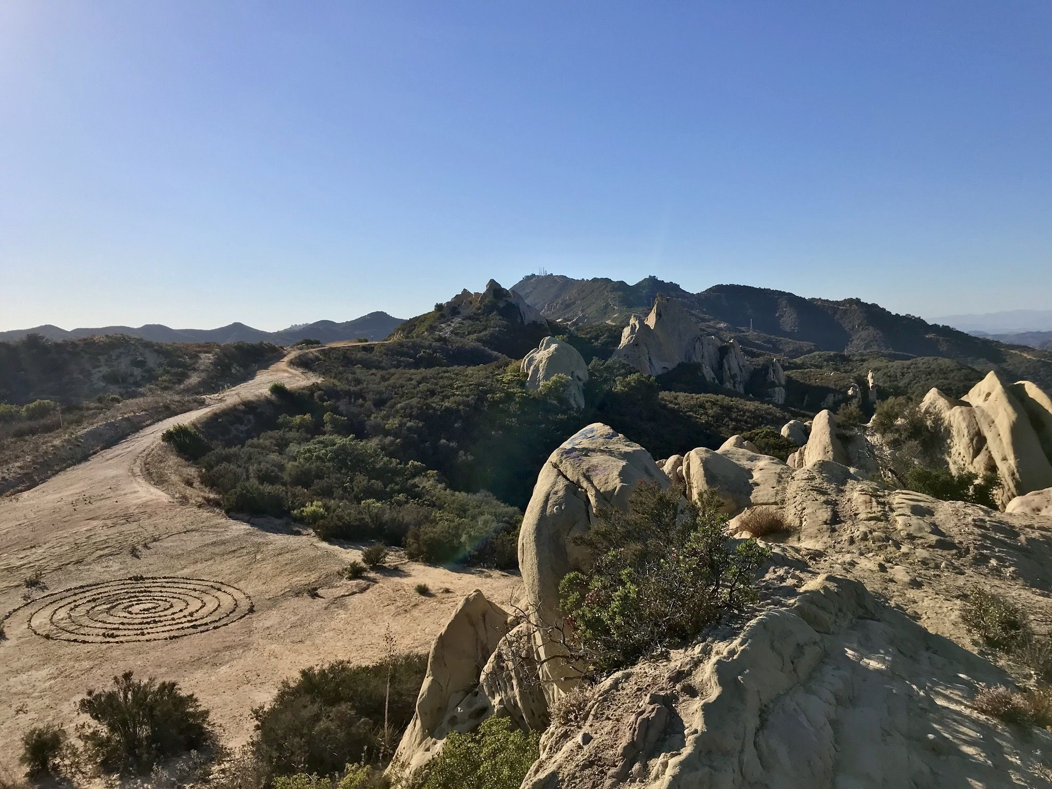 PEAK: Castro Crest - 7.6 miles and 1250 ft. of elevation gainDIFFICULTY: 3.5/5.SCENERY: ocean views from the crest, rock pinnacles, wind cavesFUN FACT: this trail features a stone art spiral that has been kept up by hikers for years!