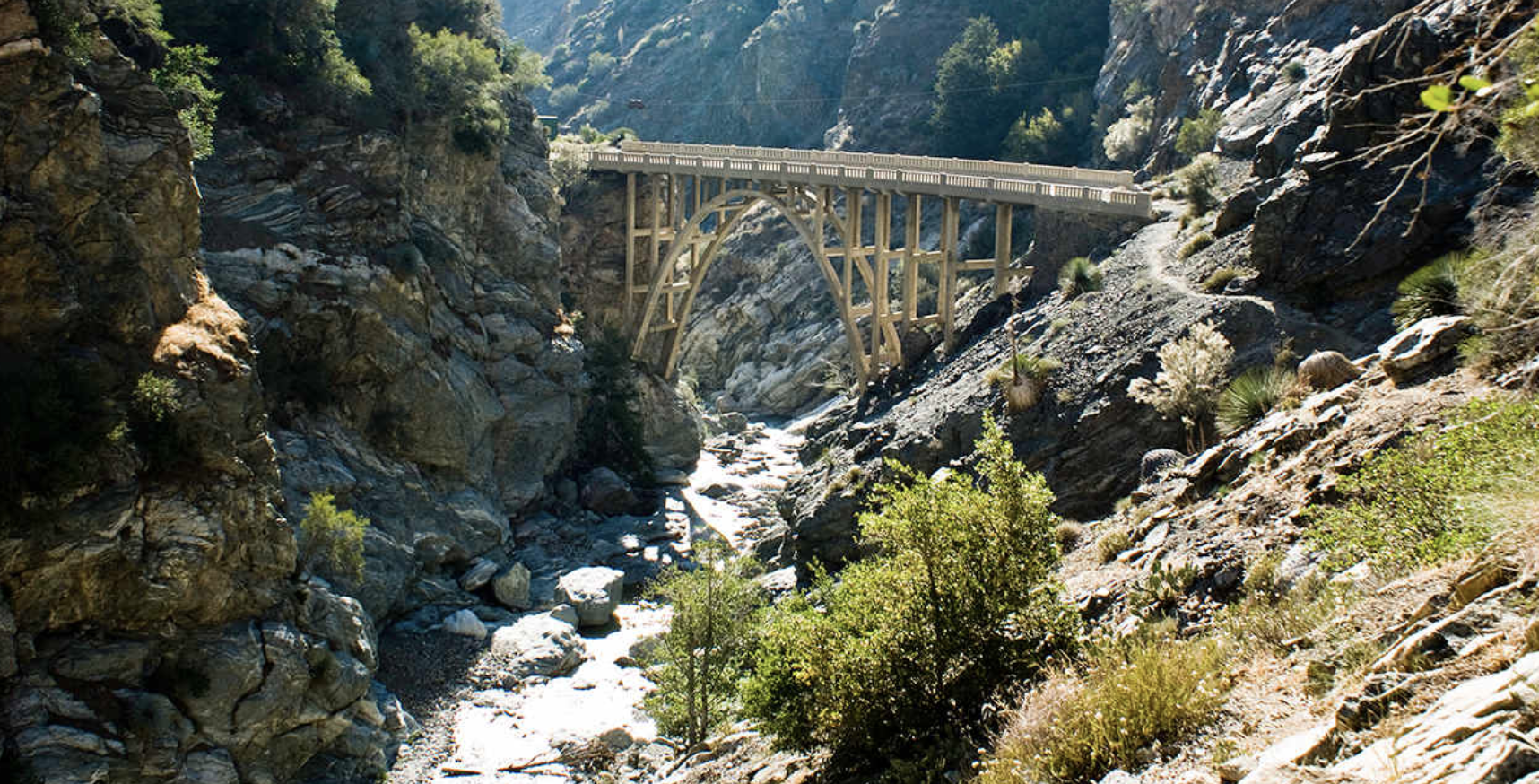 PEAK: Bridge To Nowhere - DIFFICULTY: 4/510.5 mile trail with almost 2000 ft of elevation gain and multiple river crossings!SCENERY: streams, water holes, trees, and a giant bridge!FUN FACT: Big Horn Sheep sightings are fairly common on this trail! Keep an eye out for them :)