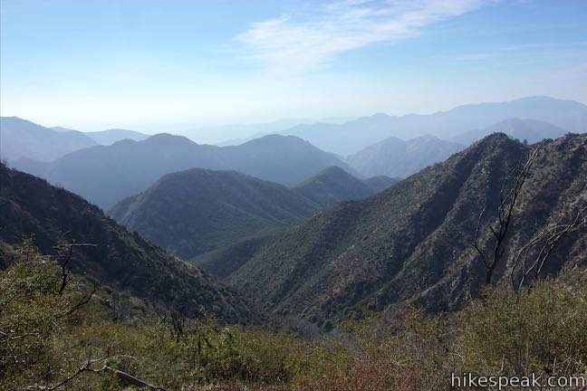 PEAK: Strawberry Peak - DIFFICULTY: 4/5SCENERY: Rolling hills, greenery, and a meadow!Distance: 7.5 milesElevation gain: 1510 ft.FUN FACT: Strawberry peak holds the highest summit on the front range of the San Gabriel Mountains.