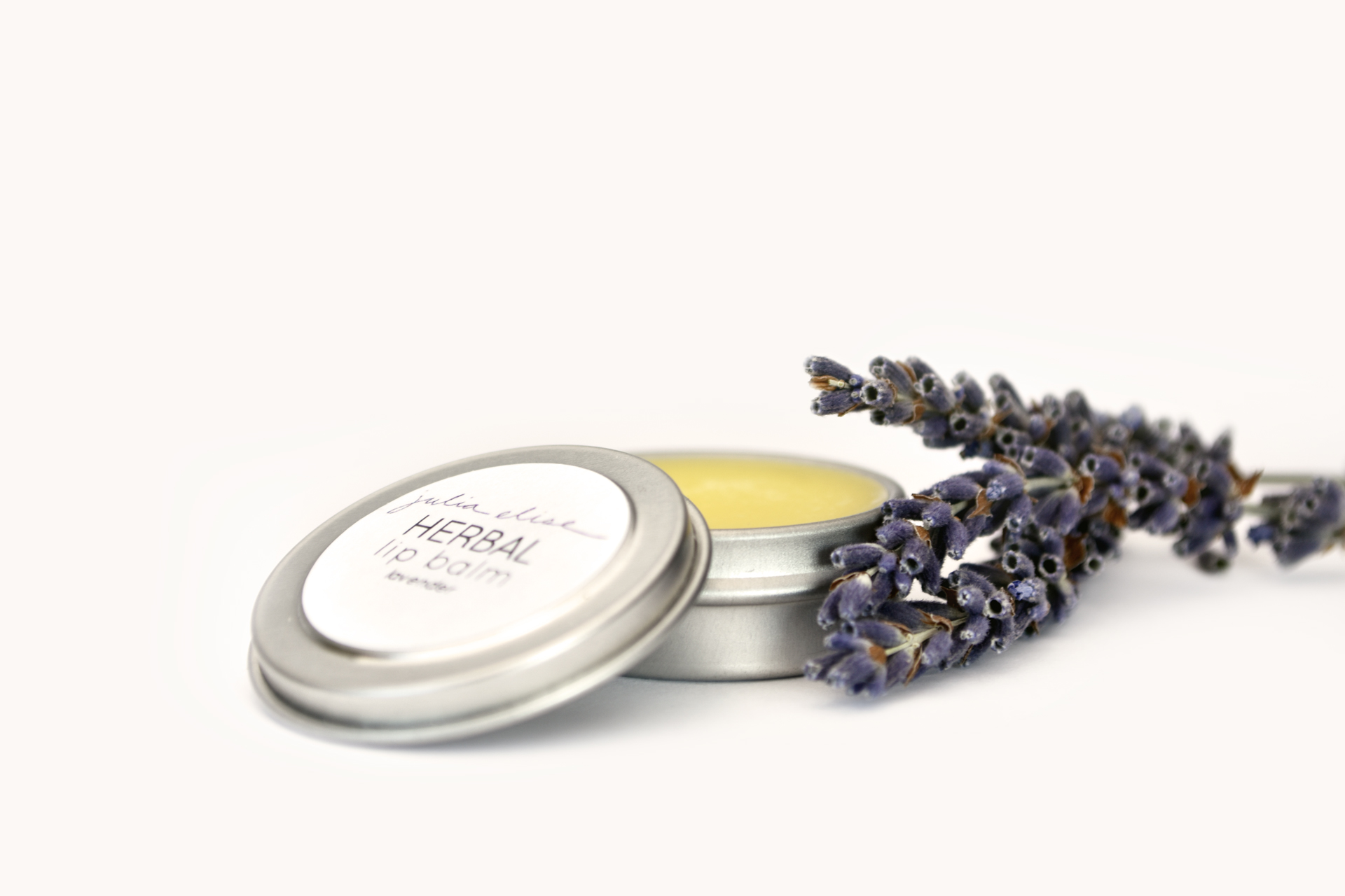 Herbal Lip Balm - LavenderSilky smooth lip balm will infuse lips with deep hydration and healing.Handcrafted in MN.Ingredients: calendula-infused olive oil, shea butter, cocoa butter, coconut oil, beeswax, vitamin e, and essential oil..25 ounce metal tin.