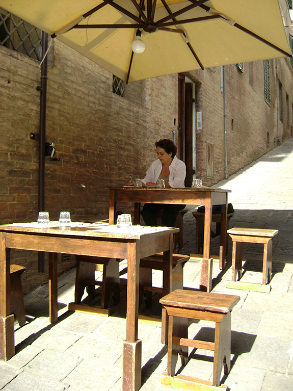 Writing at an outdoor cafe in Siena, Italy.