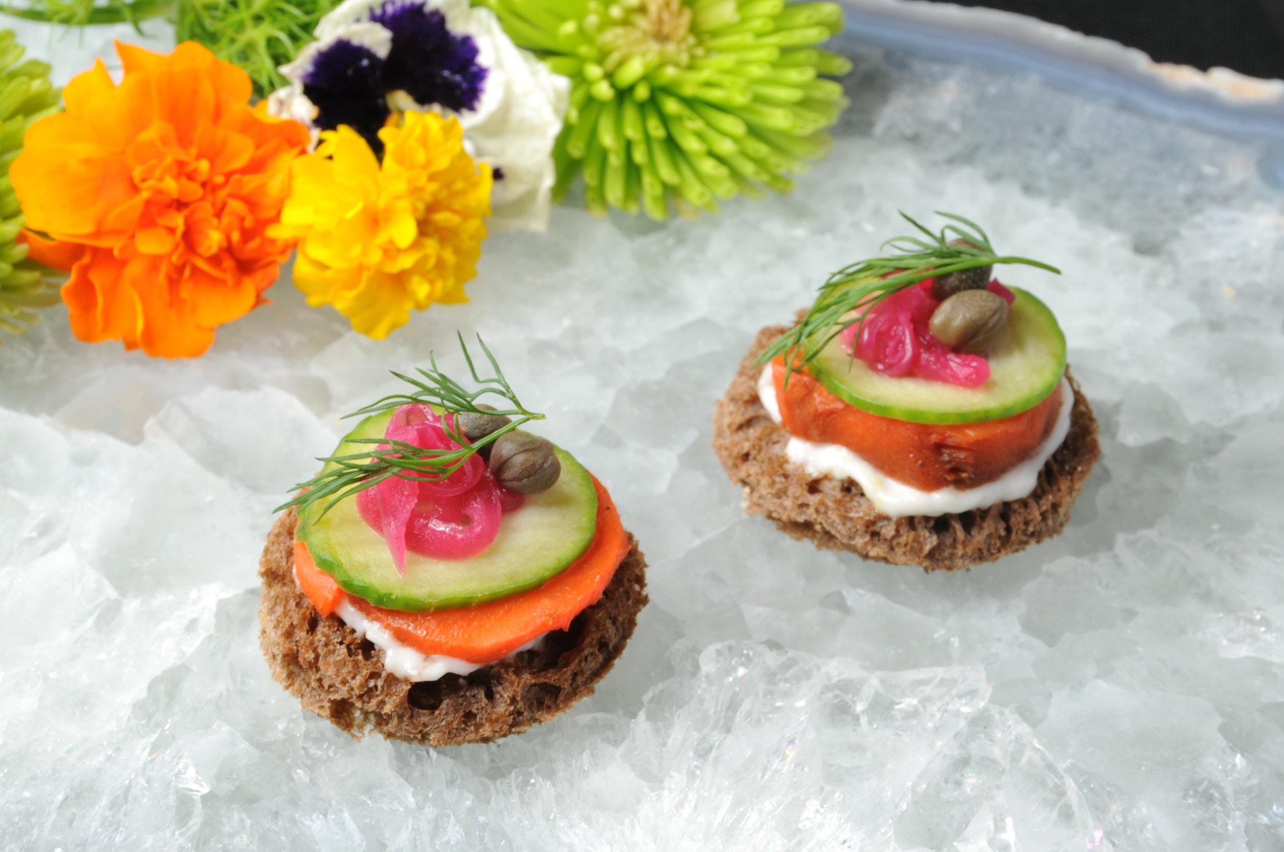 Toasted pumpernickel with carrot lox, mustard dill aioli, pickled red onion, and capers