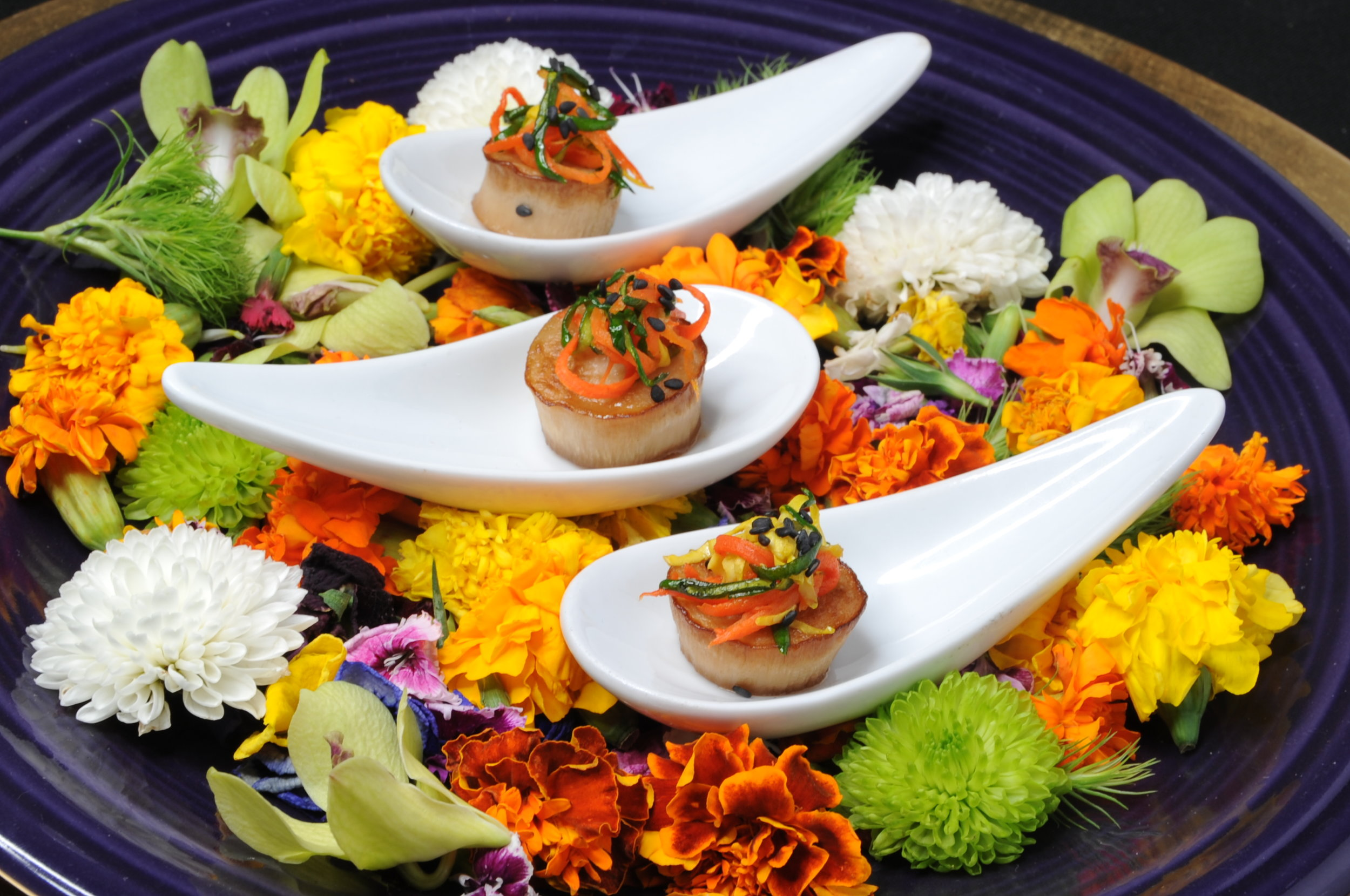 Seared miso king trumpet scallop with julienned vegetables, sake, and black sesame