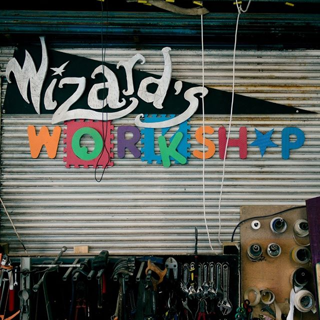 Wizard's Workshop  I spent my weekend working on set design for Crunchytown's Magic warehouse party! We already had our workshop sign, so I designed, cut out and spray painted some silver letters to turn it into a wizard's workshop sign! And I tell you what... cutting into a foam tent mat with scissors is a surprisingly satisfying task.  _