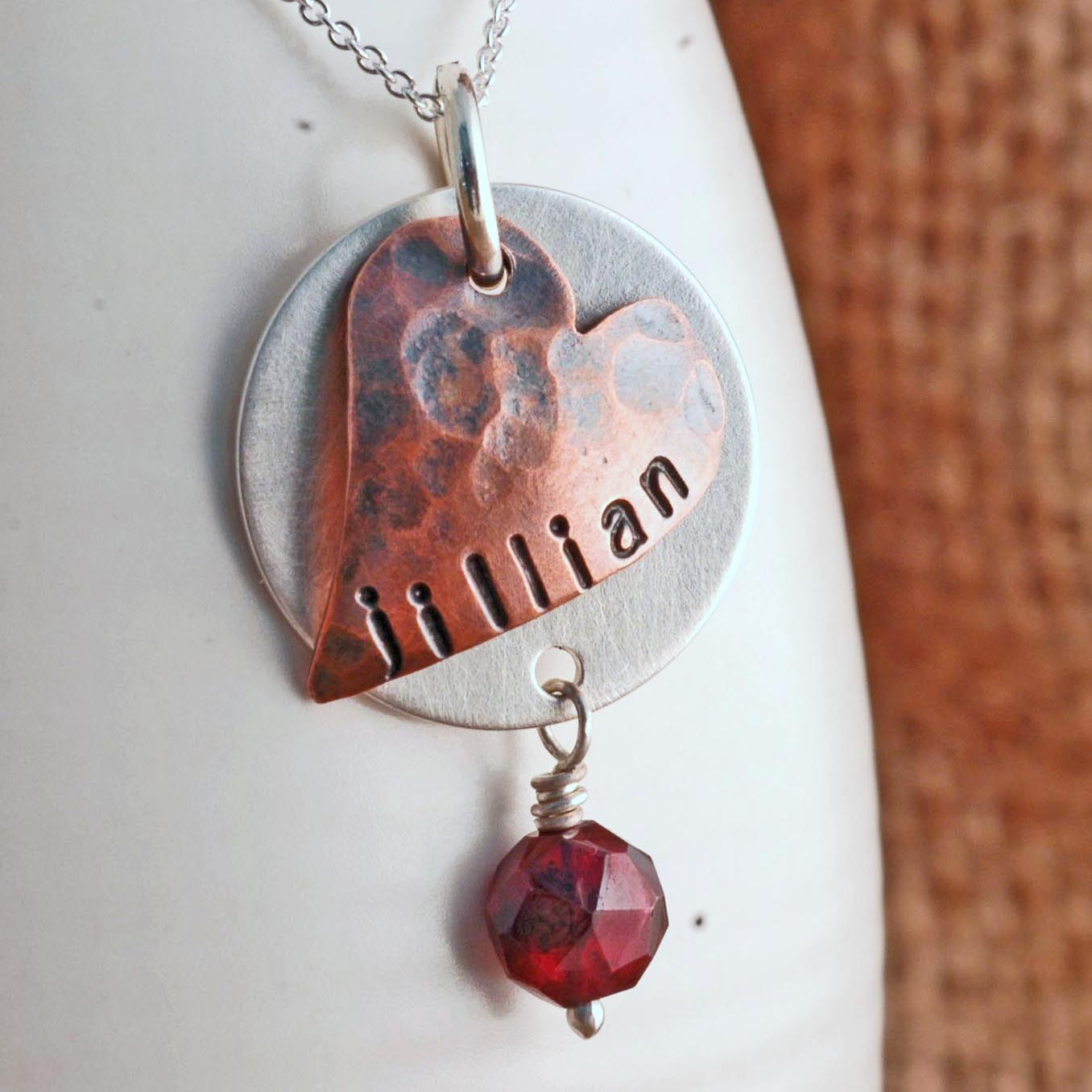 silver necklace with floating copper heart.jpg