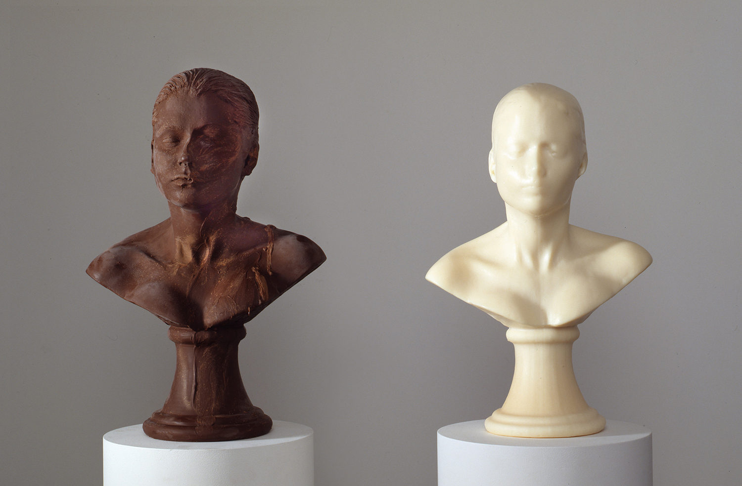 Lick and Lather , 1993, seven licked chocolate self-portrait busts and seven washed soap self-portrait busts on fourteen pedestals, image via  artist's website