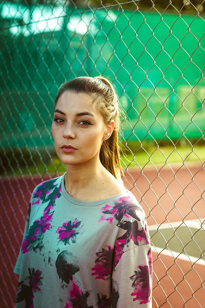Girl by fence
