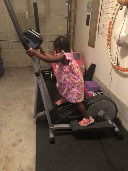 Baby Girl working out on the elliptical.