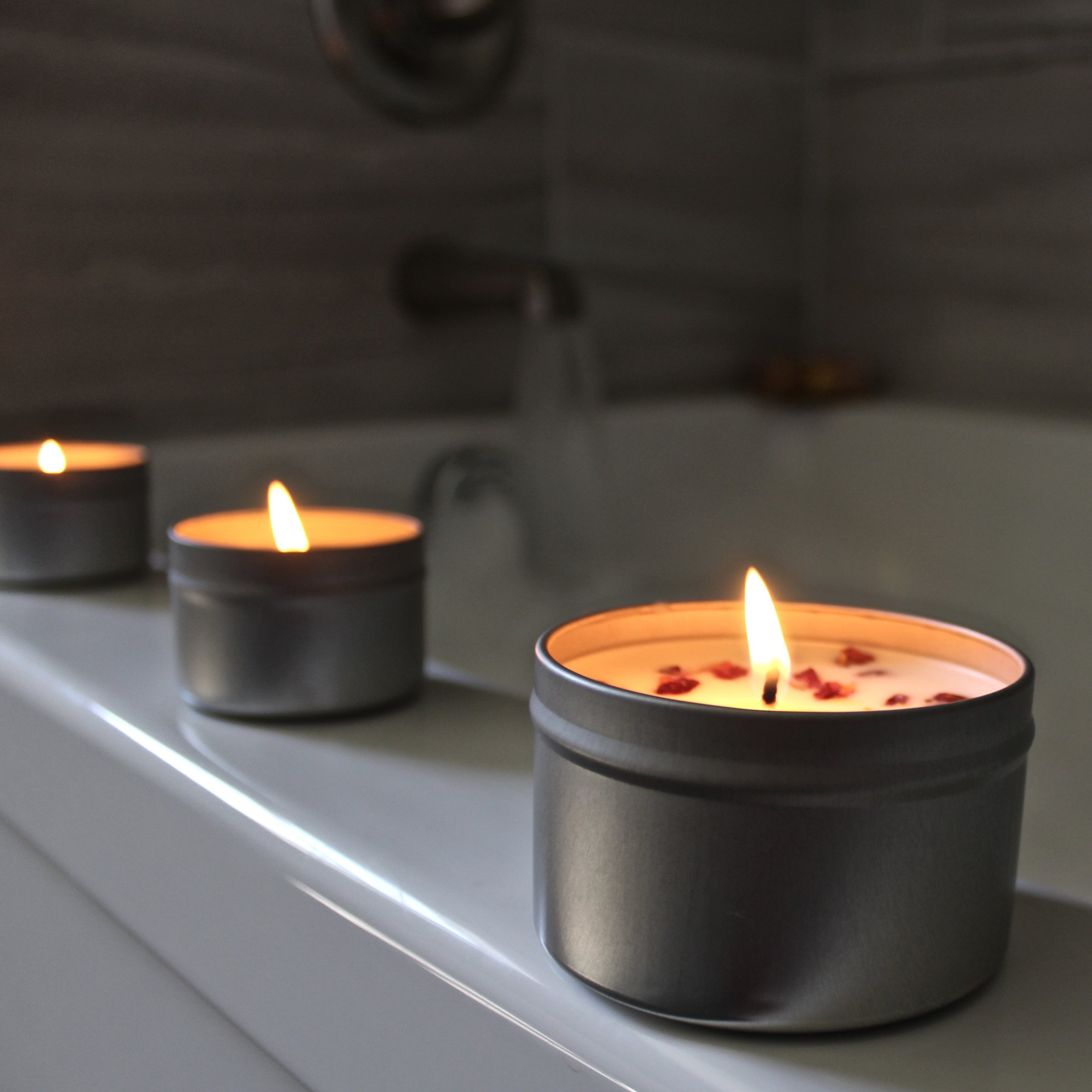 Our  Travel Tins  make it a breeze to take your favorite candles anywhere.