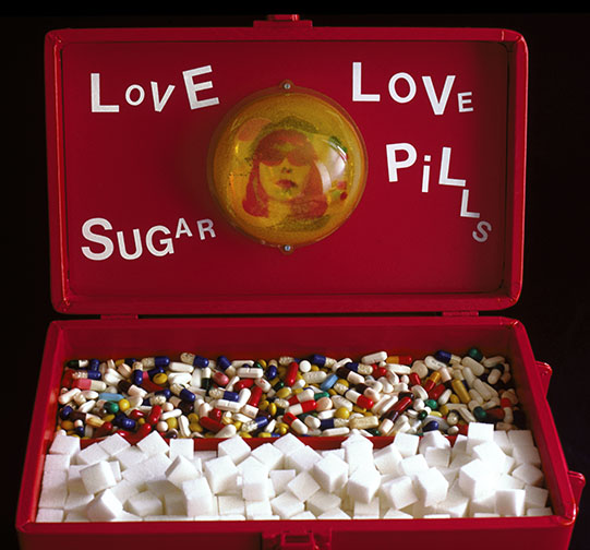 "Love Sugar, Love Pills  mixed media and resin  11"" x 13"" x 7.5""  2001"