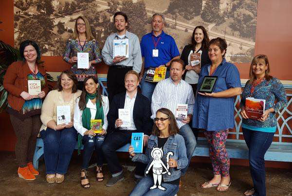 I'm holding with Lovely Traces of Hope (sitting far left) with Jeff Goins and other published authors in 2016