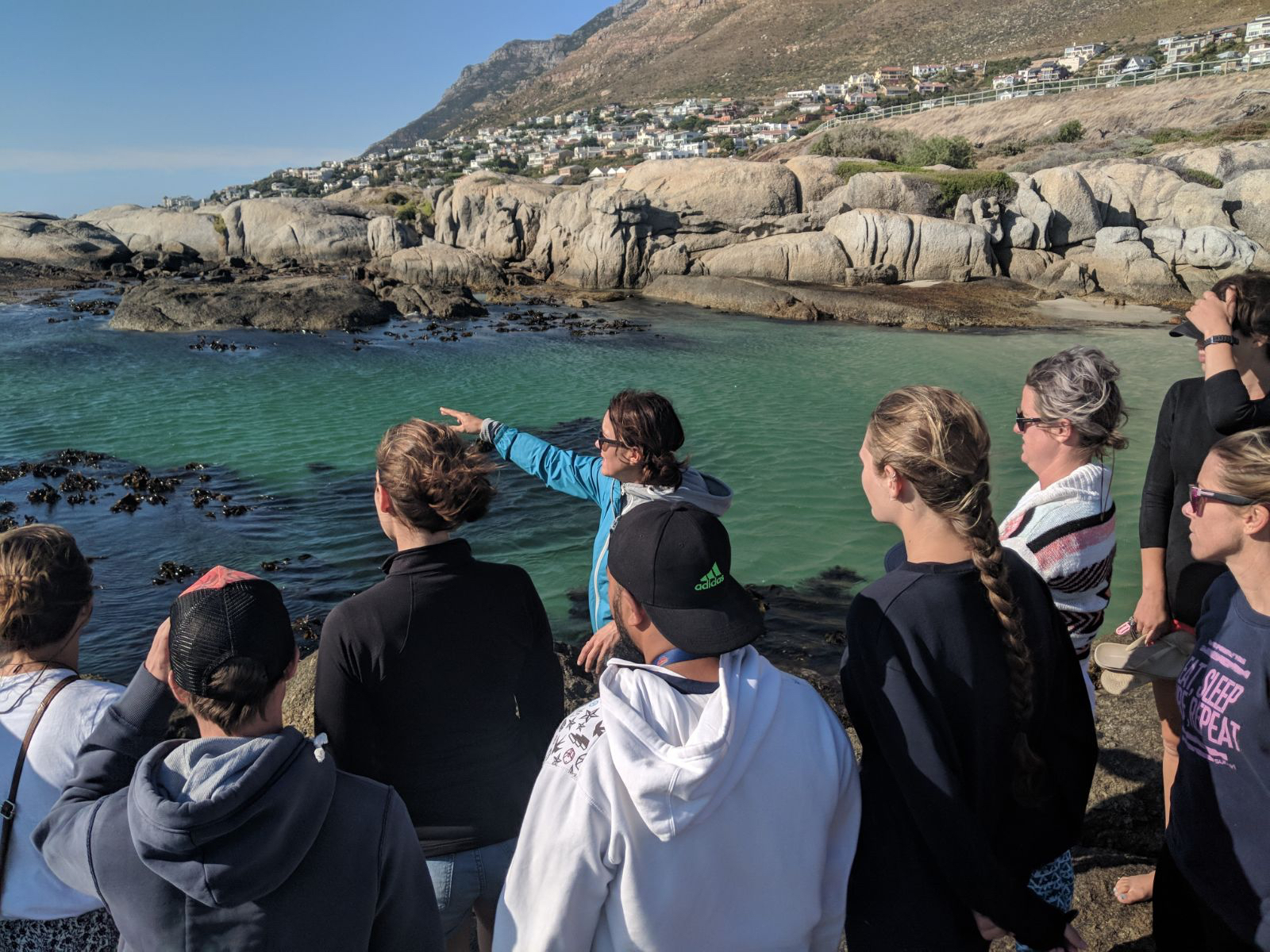 The coaches learning about the best dive spots on the Cape Peninsula.