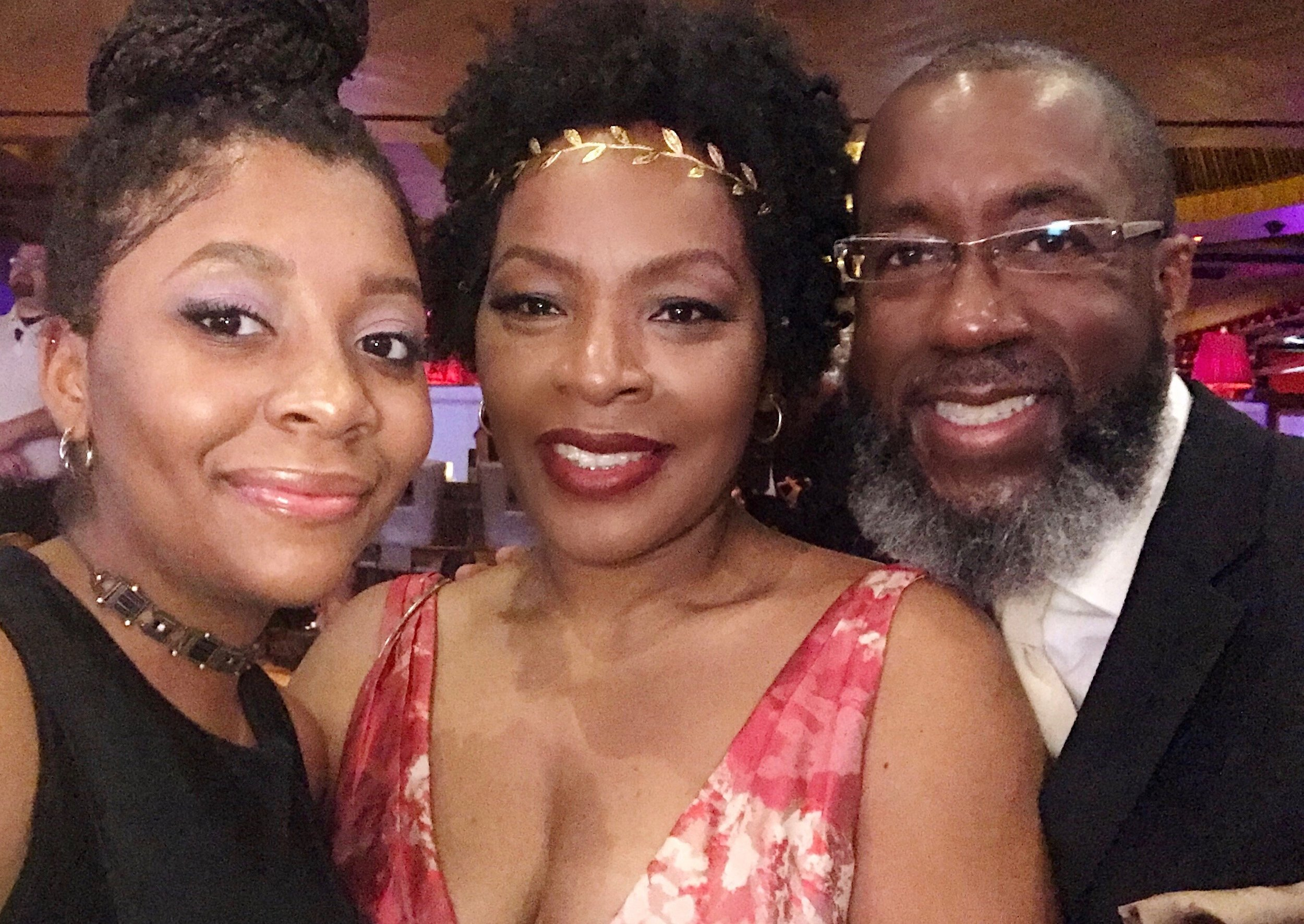 """Three members of my Beautiful and Blessed family! At the movie premiere of """"NO More""""  I'm not sure of the shadows on my chest. I just noticed that this photo is discolored. oh well!"""