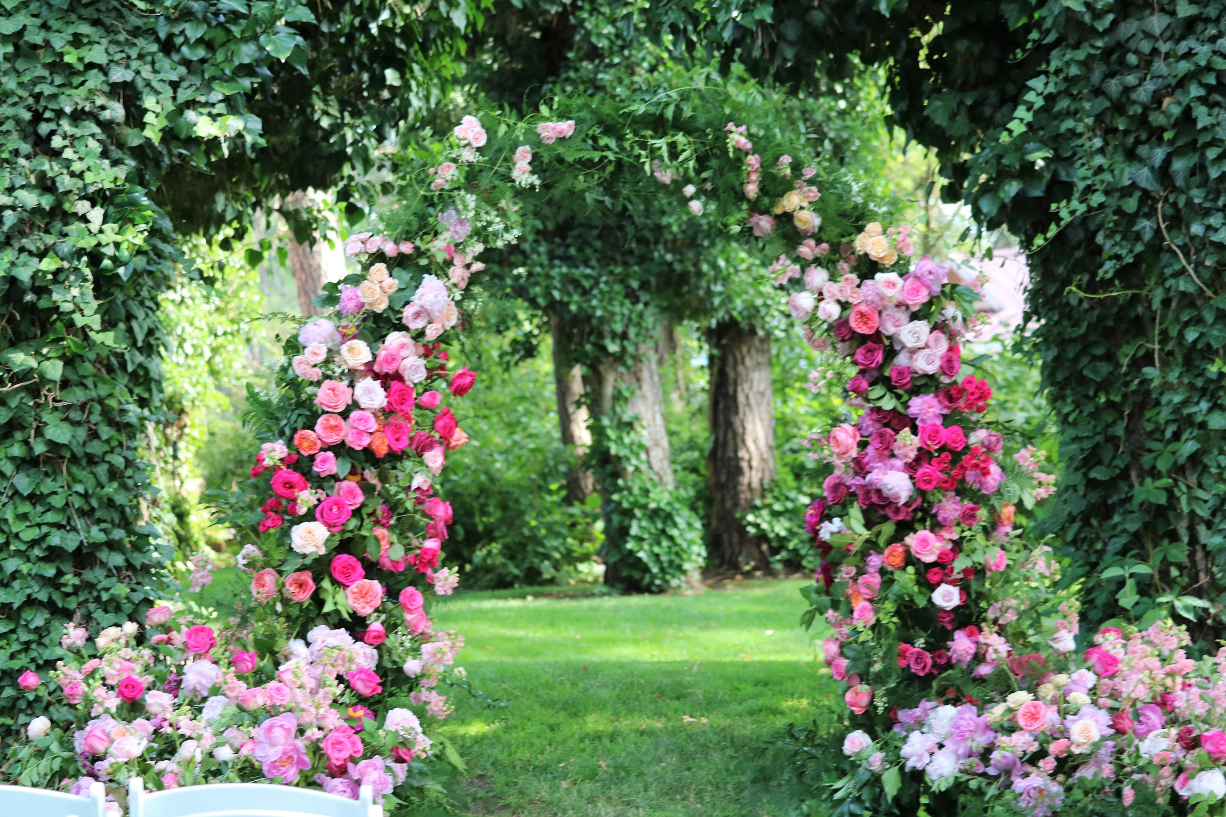 Arch at Arbor Crest Wine Cellars, Spokane, WA I was a co-creator with Beth M. of Snapdragon Flower Farm this was done for her bride.  The arch structure is a rental piece of mine