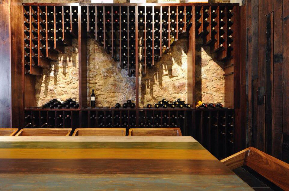 We designed and made the furnishings for the new Osteria Restaurant in Casco Viejo Panama. Here is the wine rack mounted onto the historic Calicanto walls in the wine room. Our first Osteria chairs were made for this restaurant, hence the name.