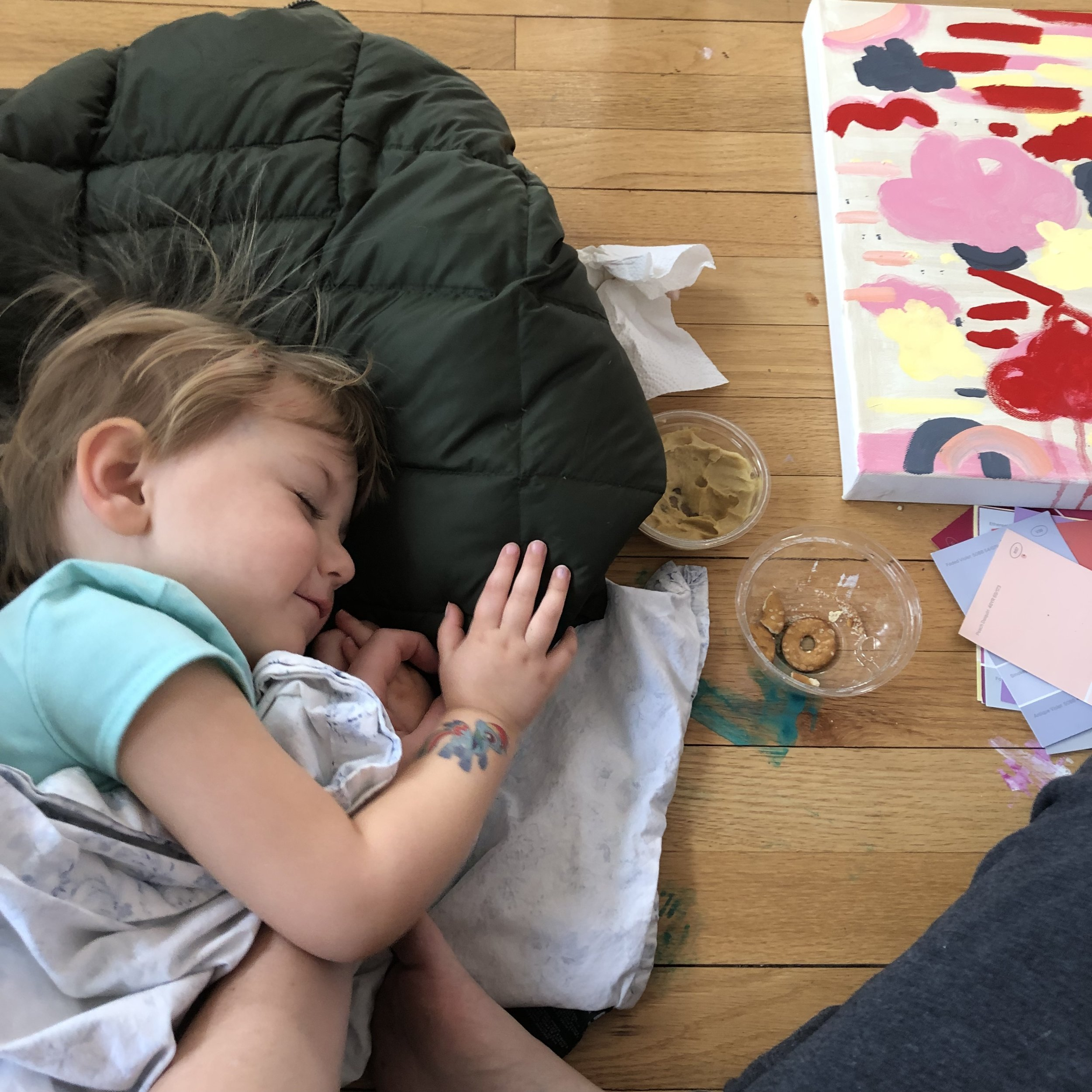 my Daughter, Cayce taking a nap in my studio while I paint