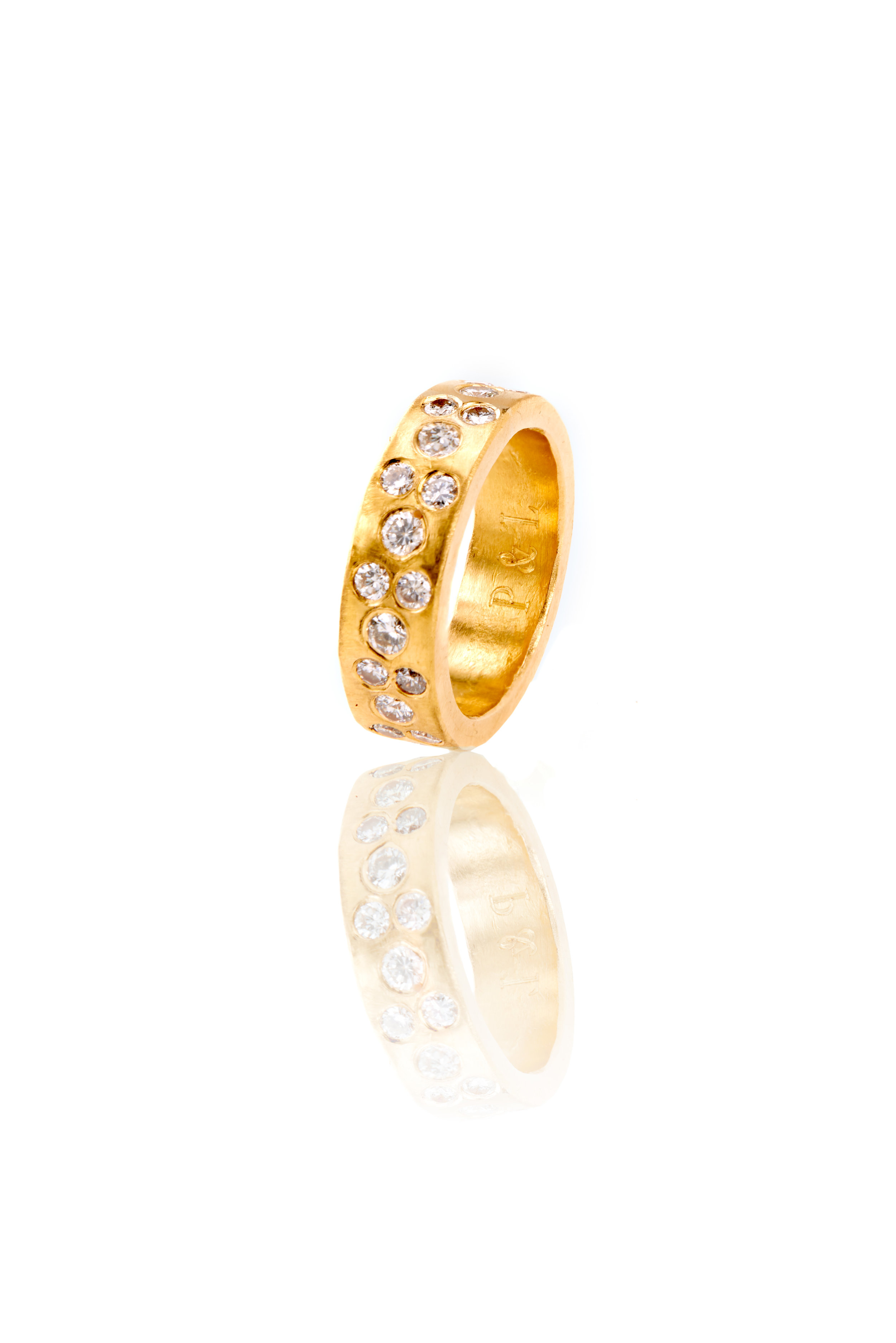 22K gold band with repurposed heirloom diamonds -