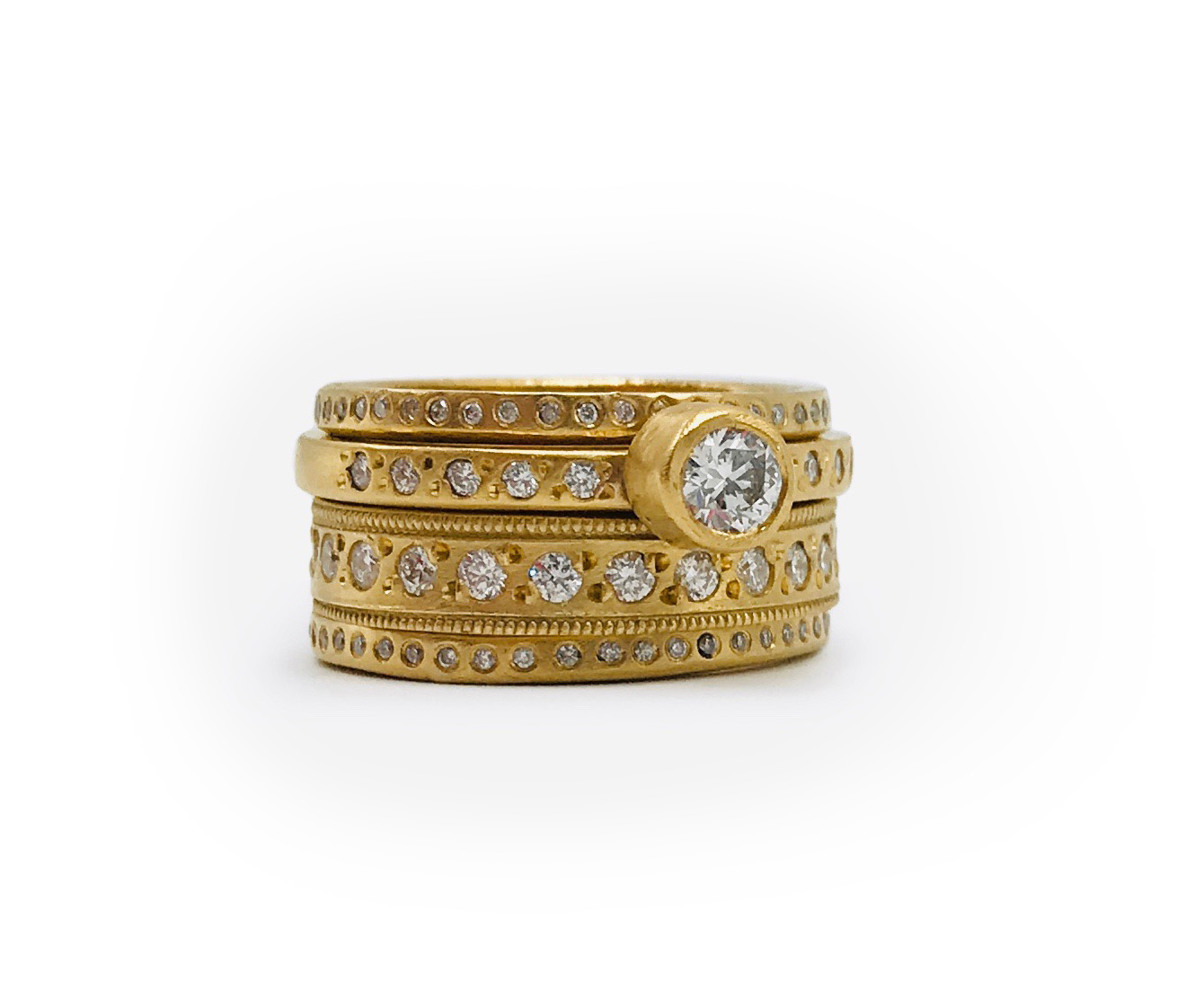 Stacking rings in 22K gold with recycled diamonds -