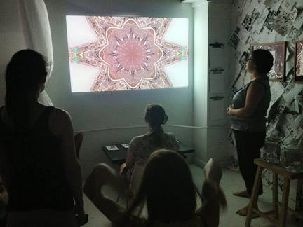 This photo was taken of participants at a collaborative event between Mindful Boston and a media artist. - How do we blend our IRL selves with the influx of technology?